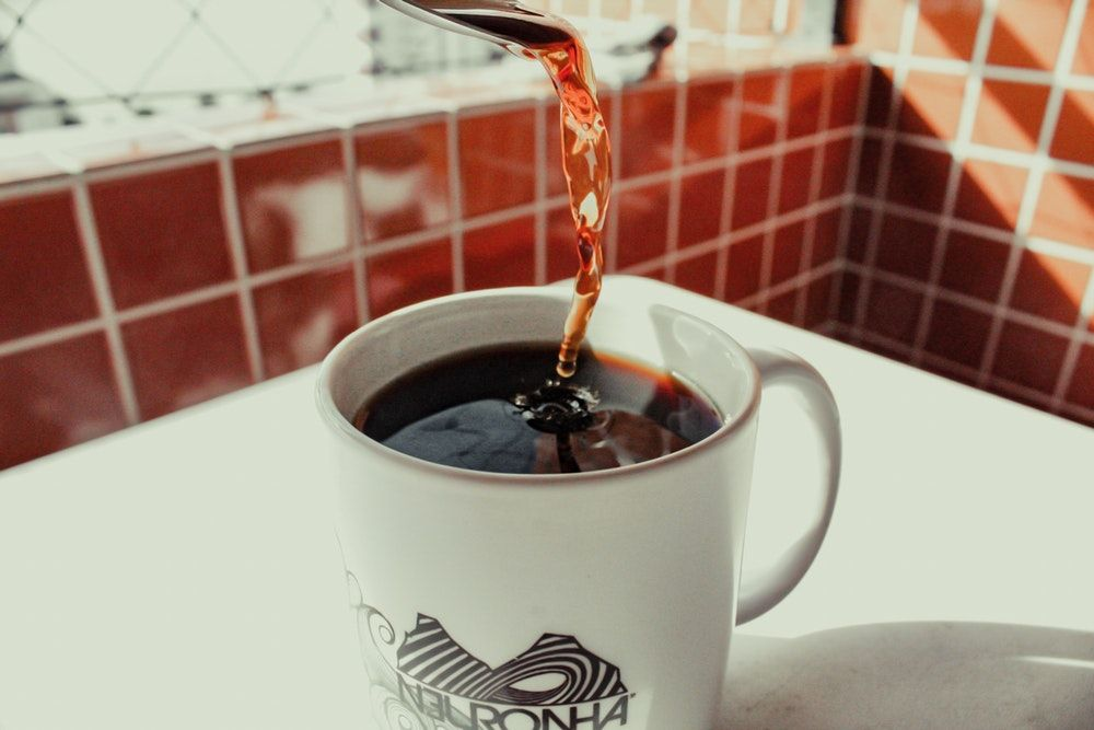 pouring black coffee