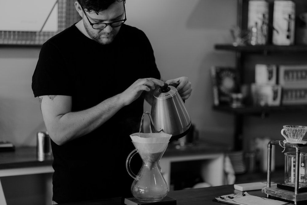 guy pouring from coffee carafe